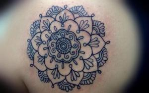 Crisp-and-clear-black-ink-lines-give-this-spiritual-flower-of-life-mandala-tattoo-design-an-elegant-appeal
